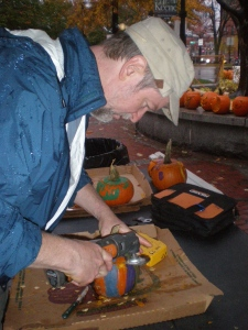 David carves out the Alzheimer's patients' pumpkins. They expressed themselves with paint. But to be part of the contest, they had to be carved!