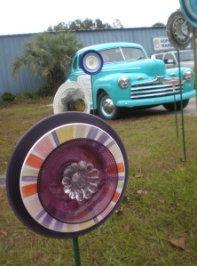 Cute lawn ornament made from odd plates/dishes. The lawn ornament in the back row with 4 wheels is nice too.