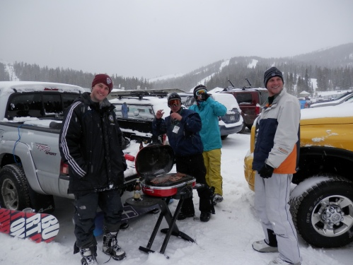 Tailgate party on the parking lot. Only seen when everyone's happy it's snowing